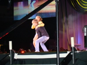 Derek Hough brings fan on stage for a dance