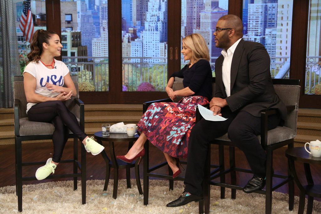 "Kelly Ripa and Tyler Perry talk with Aly Raisman during the production of ""Live Kelly"" in New York on Tuesday, Oct. 11, 2016. Photo: David M. Russell//Disney/ABC Home Entertainment and TV Distribution ©2016 Disney ABC. All Rights Reserved."